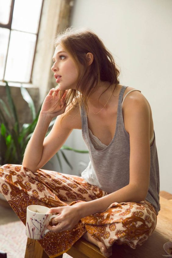 a grey top, colorful boho printed pants for a relaxed and slightly gypsy look at home