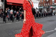 a hot red wrap midi dress with a pleated skirt, a black bag and white trainers for a trendy look