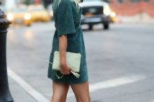 a hunter green suede mini dress, a light green clutch and tan Greek sandals for a wow look