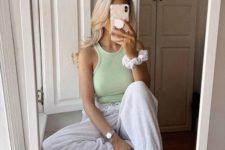 a light green halter neckline top, dove grey joggers, white socks for a sporty look at home