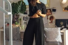 a minimalist black loungwear set with a crop top with short sleeves and wideleg pants is cool