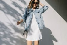 a minimalist white mini dress, a blue denim jacket, grey loafers for a spring to summer look