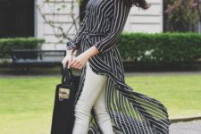 a monochromatic look with a black striped shirtdress, white skinnies, black lace up shoes and a statement black bag