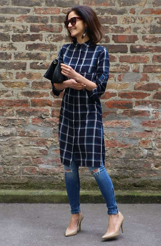 a navy plaid knee shirtdress, blue ripped skinnies, tan shoes and a black bag for a chic look