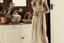 a neutra linen midi dress with a ruffled neckline and sleeves is very comfortable and all-natural