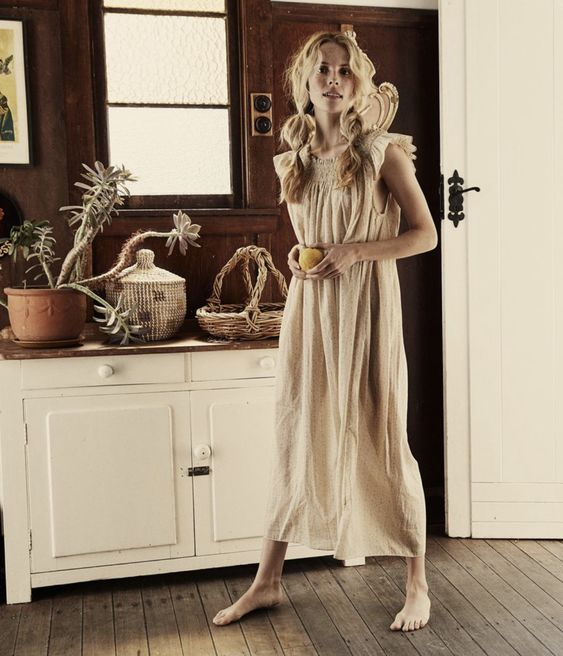 a neutra linen midi dress with a ruffled neckline and sleeves is very comfortable and all natural