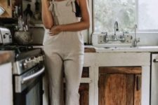 a neutral linen overall and a black lace bralette for a simple and chic look at home