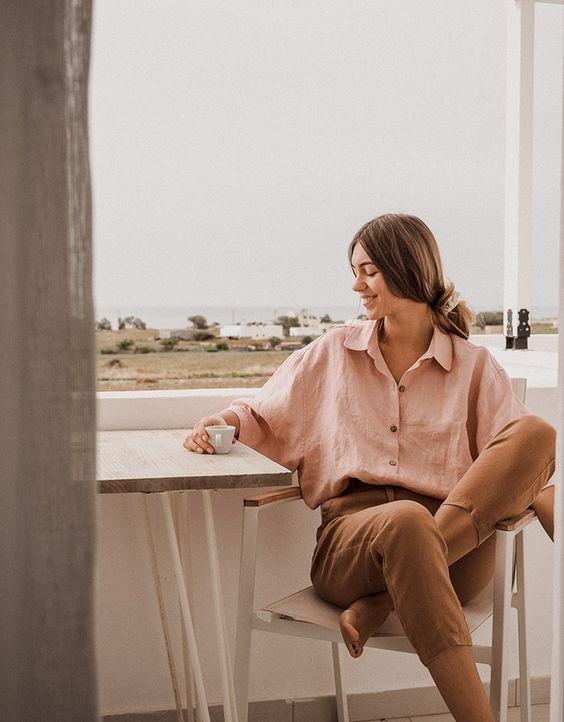 a pink linen oversized shirt and brown cropped pants for a cute every day look