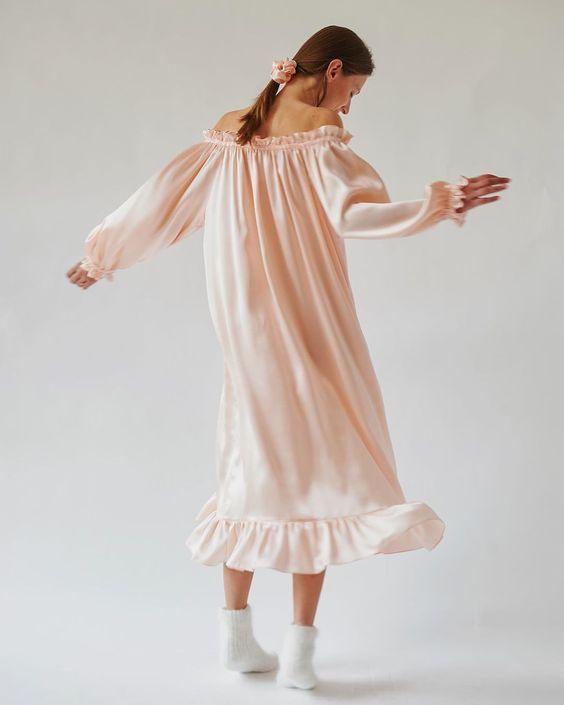 a pink off the shoulder midi dress with ruffles and long sleeves looks cute, chic and very girlish