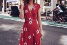 a red wrap floral midi dress, tan slippers and a wicker bag for a perfect hot summer day look
