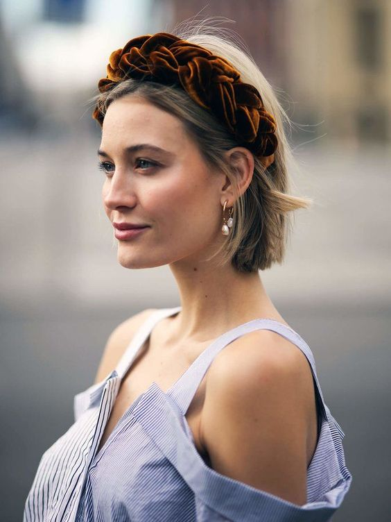 a rust-colored braided velvet padded headband is a gorgeous accesosry to wear in and out