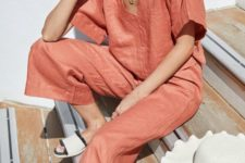 a rust-colored linen set with a short sleeve top with a V-neckline and cropped pants is bold
