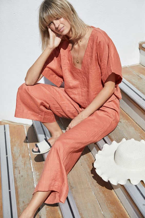 a rust colored linen set with a short sleeve top with a V neckline and cropped pants is bold