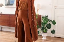 a rust-colored loungewear suit with a lace neckline top, wideleg pants and a long robe with a star print