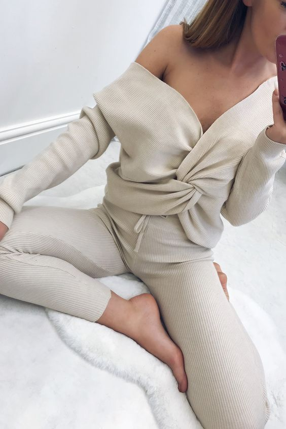a sexy neutral loungewear set in off white with an off the shoulder bow top and leggings