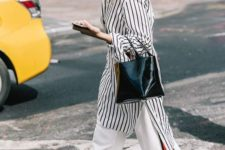 a striped knee shirtdress, white pants with red stripes, a black bag and black shoes