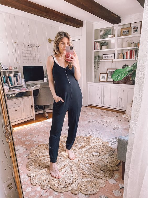 a white lace bra and a sleek black overalls with buttons is a stylish and cool look to work from home