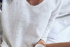 a white lace bralette and a white crochet top make up a cool and simple look for a relaxed day at home