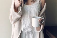 a white lacey night gown, a white lace bralette and a neutral cardigan for a chic and sexy look at home
