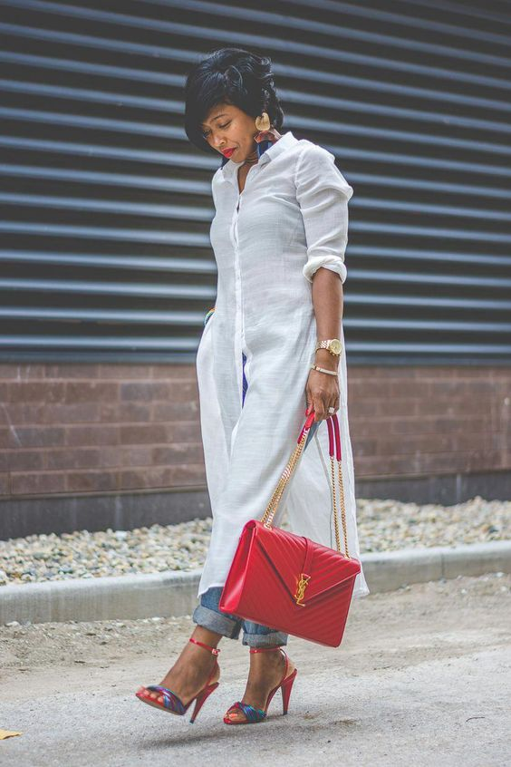 a white midi linen shirtdress, blue cuffed jeans, colorful shoes and a bold red bag for a casual look