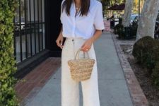 a white shirt, neutral pants, chic black slippers and a basket bag for a summer feel