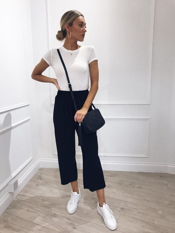 a white tee, black cropped pants, white sneakers and a black crossbody for a monochromatic look