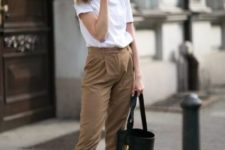a white tee, brown cropped pants, black Greek sandals and a black bucket bag