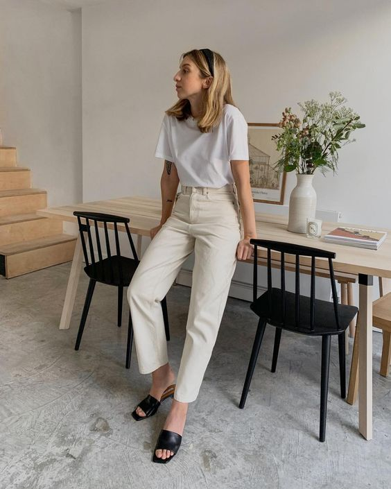 a white tee, neutral high waisted jeans, black mules and a black headband for a simple and chic look