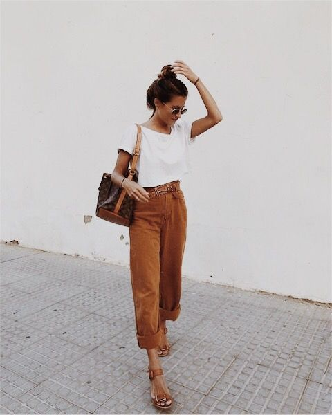 a white tee, rust colored pants, cognac sandals and a large brown bag for a comfy look