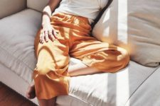 a white tee, yellow cropped wide trousers for a comfortable and stylish look at home