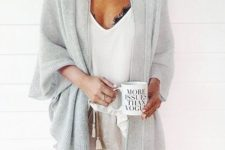 a white top, a black bralette, neutral shorts and a grey duster for a sexy and comfy look