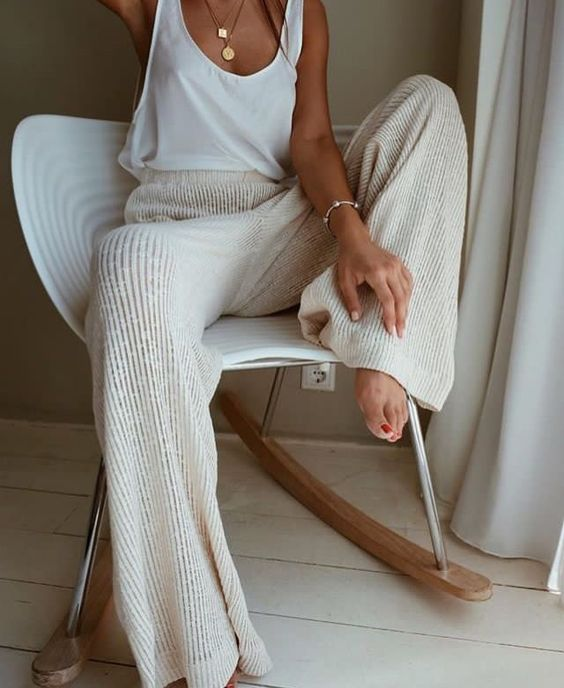 a white top and neutral wide pants for a simple and minimalist chic look at home right now