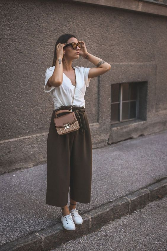 an oversized white tee, taupe high waisted culottes, white sneakers and a brown corssbody bag
