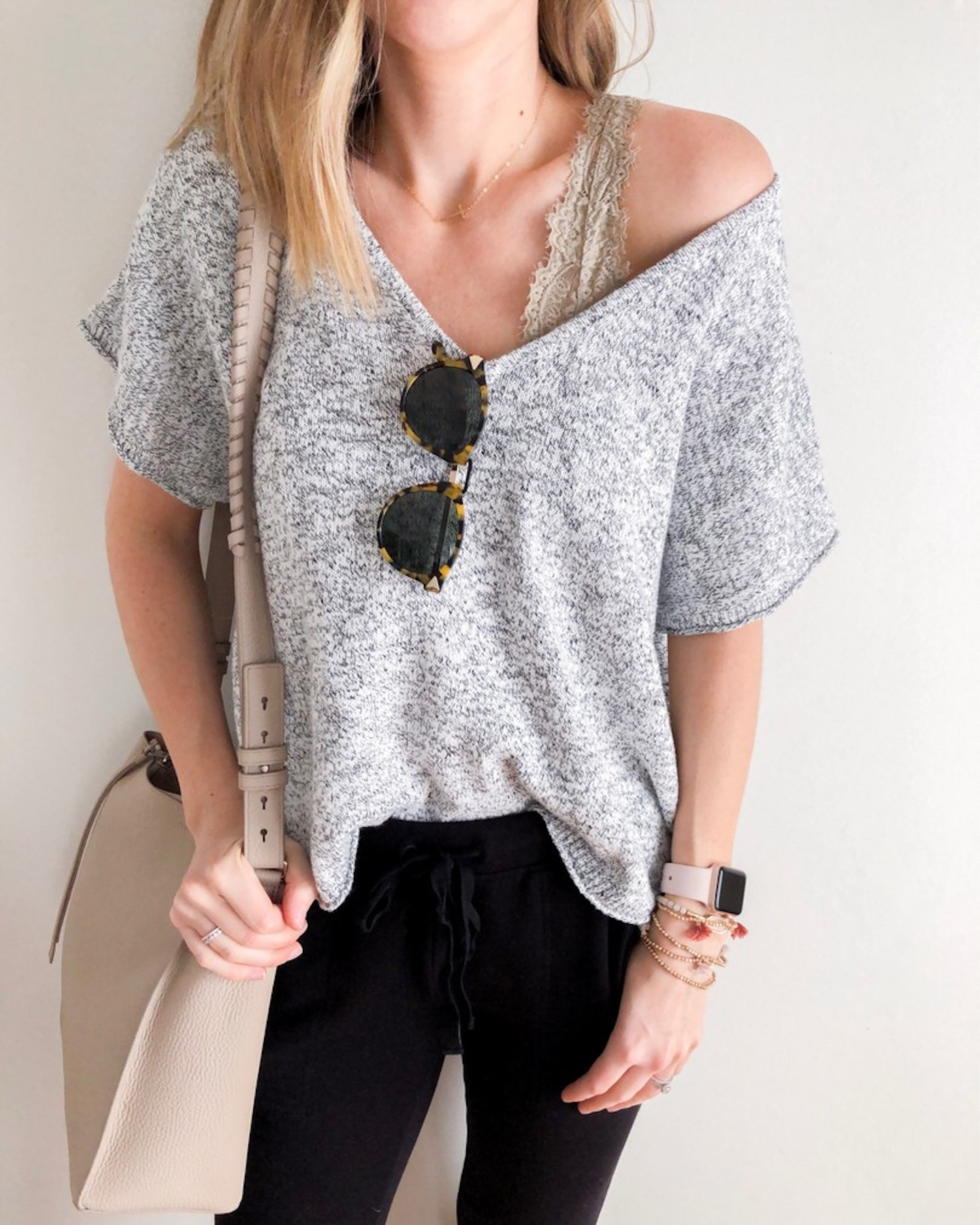black joggers, a grey crochet oversized top and a grey lace bralette for a casual home look