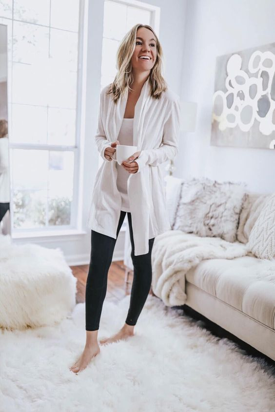 black leggings, a white top and a white duster for a chic and monochromatic look during quarantine