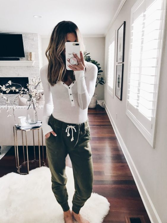 grene joggers and a long sleeve top on buttons for a cool and simple quarantine look