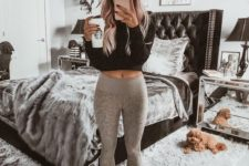 grey leggings and a black long sleeve crop top guarantee not only comfort but also chic