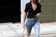light cropped jeans, a black grilish top with ruffles, tan Greek sandals and a wicker bag