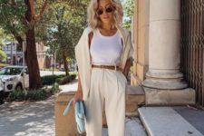 neutral high waisted pants, a white top, tan shoes, a neutral top, a light blue clutch