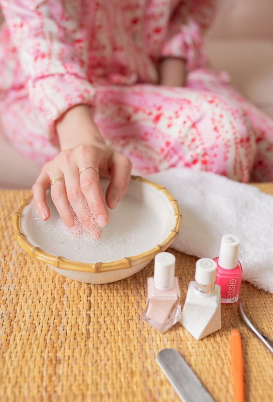 soak your nails in warm water for some time and then push the cuticles aside