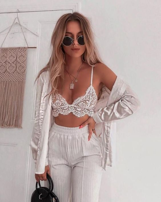white striped pants, a white lace bralette and a white silk shirt for a stylish and a statement look