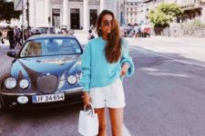 02 a blue sweater, white mini shorts, white trainers and a white bucket bag for a spring to summer look or a summer to fall one