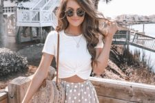 04 a romantic look with a draped white tee, blush polka dot mini shorts, a woven round bag for summer