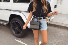06 a modern summer look with a black oversized tee, blue denim shorts, white sneakers and a black crossbody