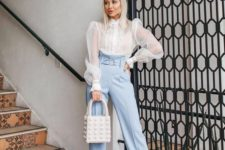 09 a romantic outfit with powder blue pants, a white sheer blouse with puff sleeve, nude shoes and a white bag