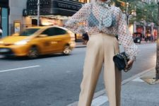 10 a trendy look with a sheer polka dot blouse, tan cropped pants, black heels and a black bag