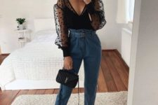 11 a stylish look with blue high waisted jeans, a black polka dot blouse, black lace up heels and a black bag