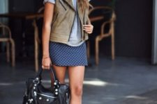 16 an early fall look with a navy polka dot mini, a grey tee, a grey leather waistcoat, grey booties and a black bag
