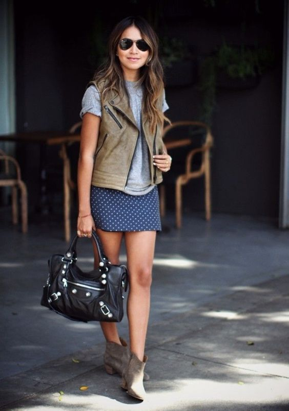 an early fall look with a navy polka dot mini, a grey tee, a grey leather waistcoat, grey booties and a black bag