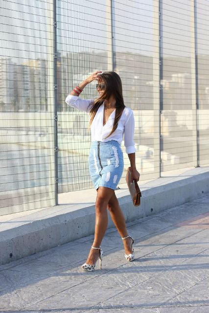 With V-neck blouse, clutch and embellished high heels